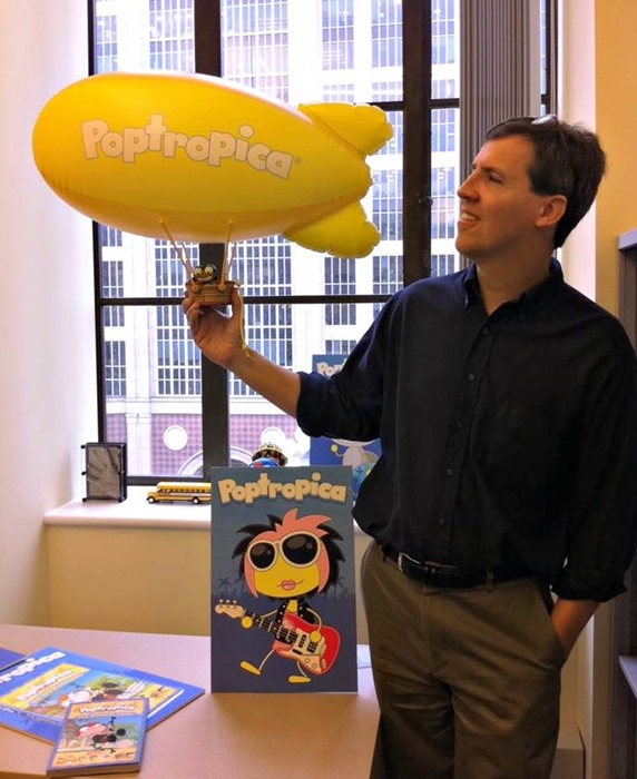 Jeff Kinney with a Poptropica blimp