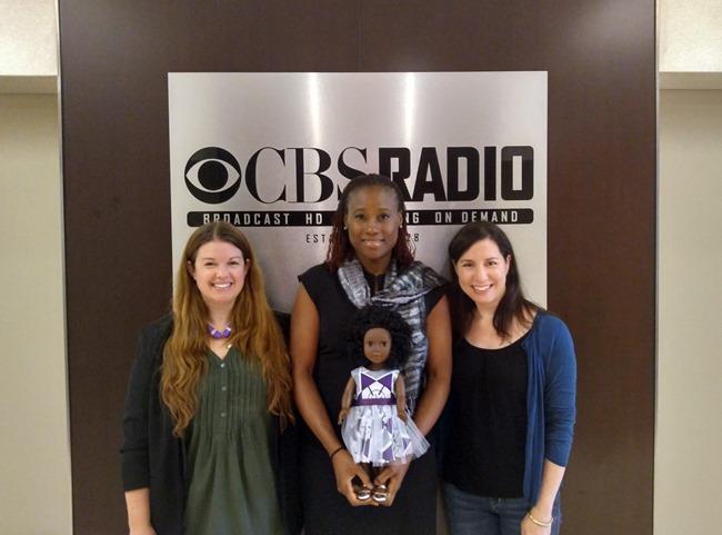 Amy, Ozi, and Rebecca with an Ikuzi doll