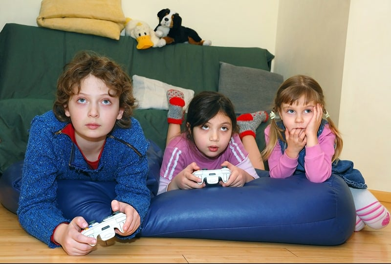 Teens playing video games
